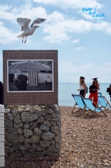 Graduates from the University of Brighton, by the photography exhibition on Brighton Beach before their graduation ceremony begins, July 2017