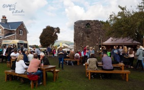 Festival goers enjoying street food in the medieval castle grounds